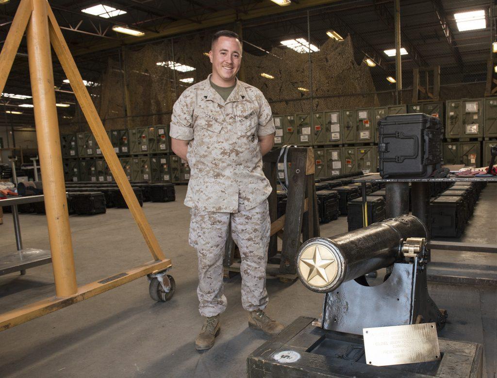 Corporal Shawn O'Kane, USMC, standing next to General Pendleton's cannon.